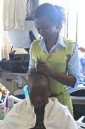 Elizabeth Awour in a KMET  training salon