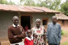 Delbert with his cousin, Mother, Grace Osimbo Wanjala, and brother