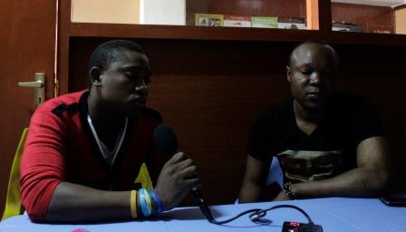 Victor, left, and Felix volunteer as peer educators with KASH.