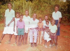 Family photo with older siblings. Nyanya, the youngest in the photo, sits in his mother's lap.